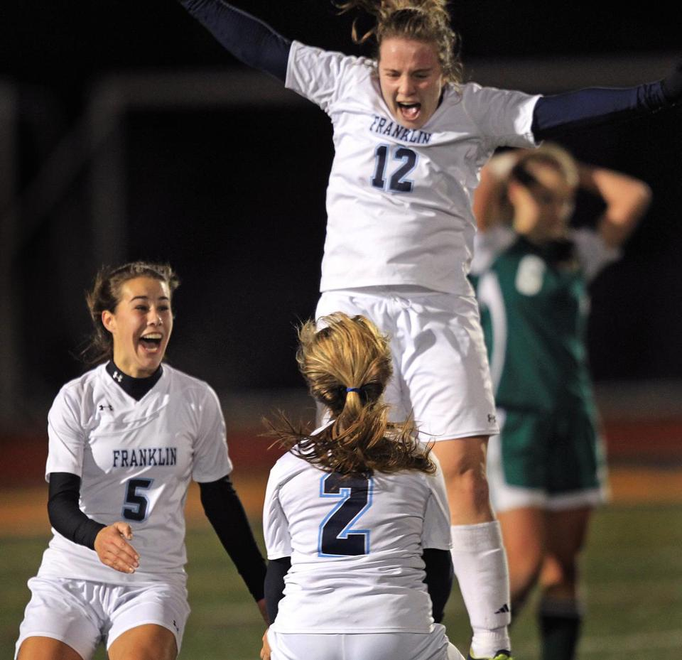 Kristi Kirshe (12) jumps for joy as Franklin defeated Nashoba to win the Division 1 girls' soccer championship.