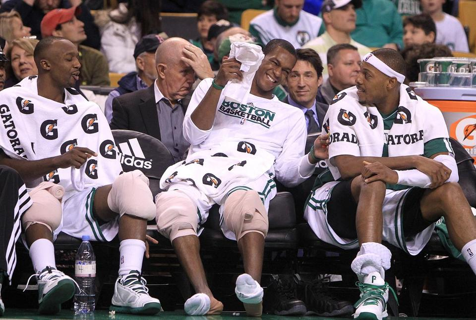 Celtics point guard Rajon Rondo (center) shared a laugh with Jason Terry (left) and Paul Pierce.