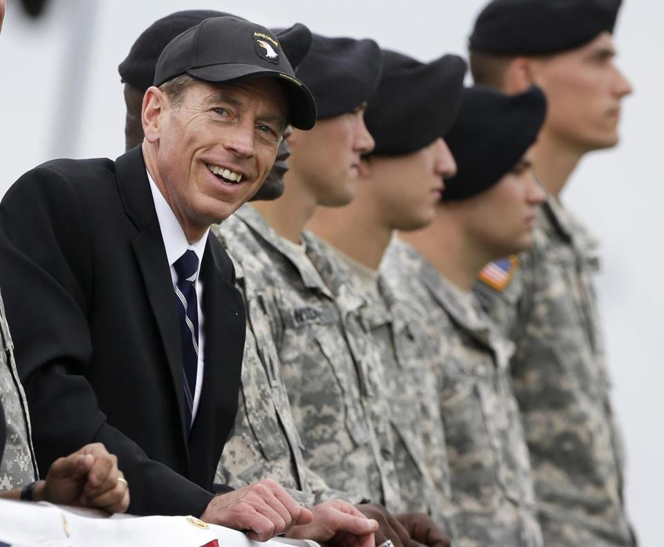 David Petraeus, left, attends the 70th anniversary of the 101st Airborne Division in August in Fort Campbell, Ky.