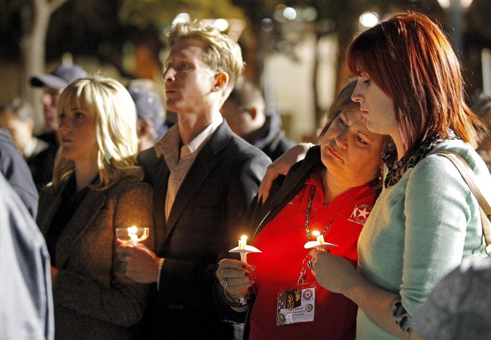 A candlelight vigil was held in Centennial Plaza in Midland, Texas, in honor of four veterans killed in the crash.