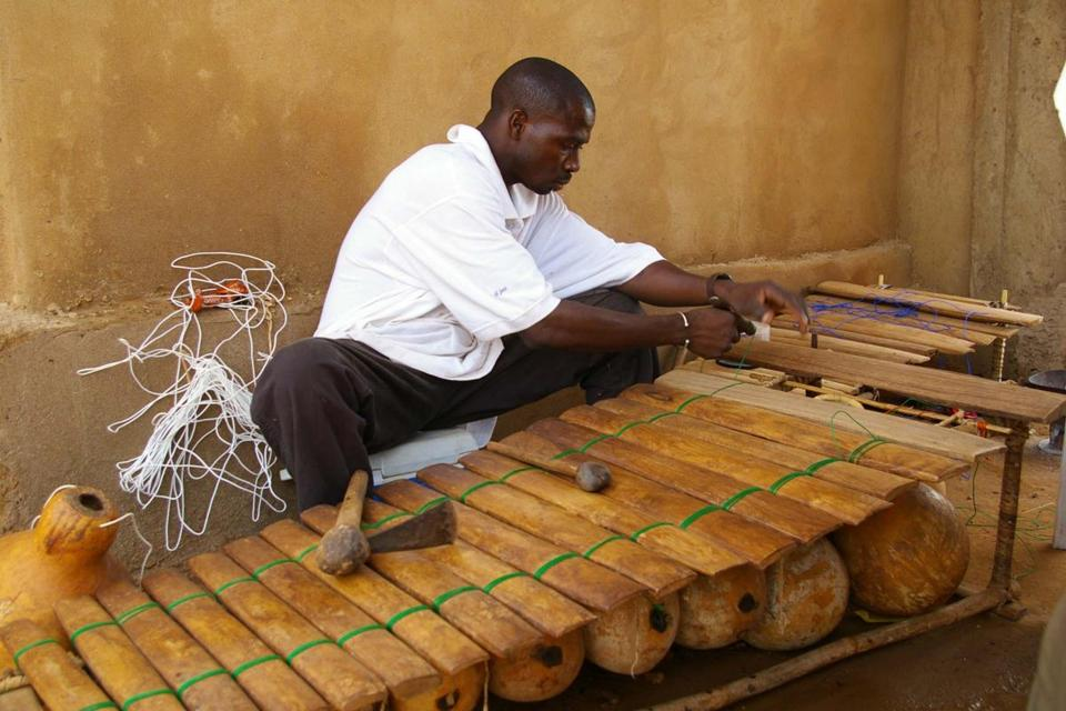 Malian musician Neba Solo at work making a balafon. Solo has brought innovation to the traditional instrument, building ones with added keys and inventing new tunings to interact with modern instruments.