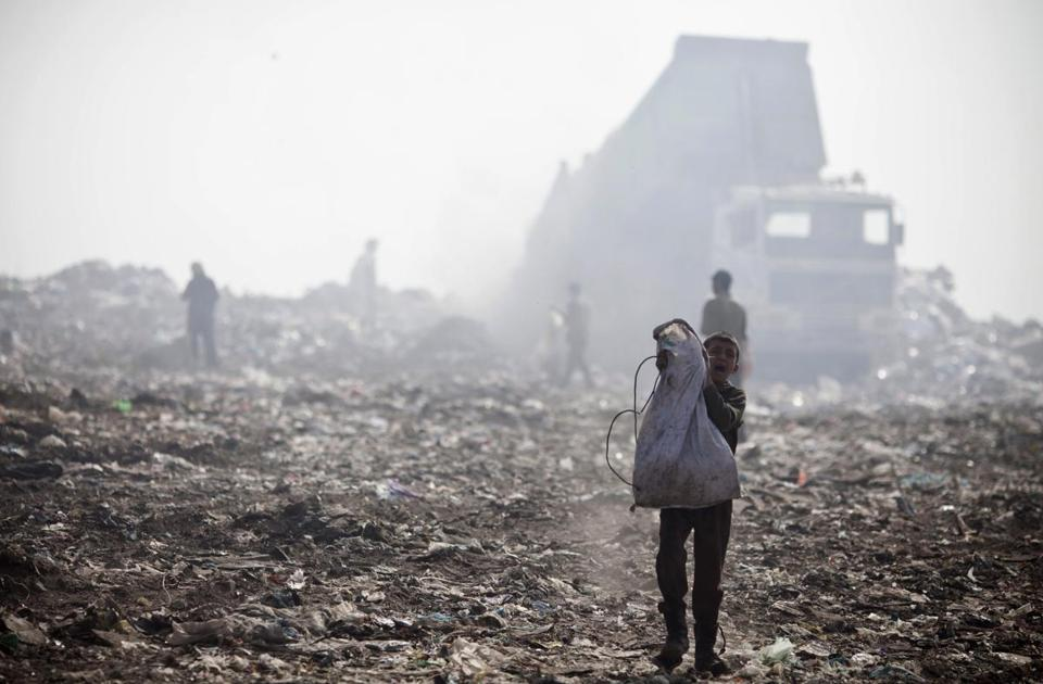 A young Palestinian boy carries a bag with scavenged plastic in a dump outside Gaza City earlier this month.