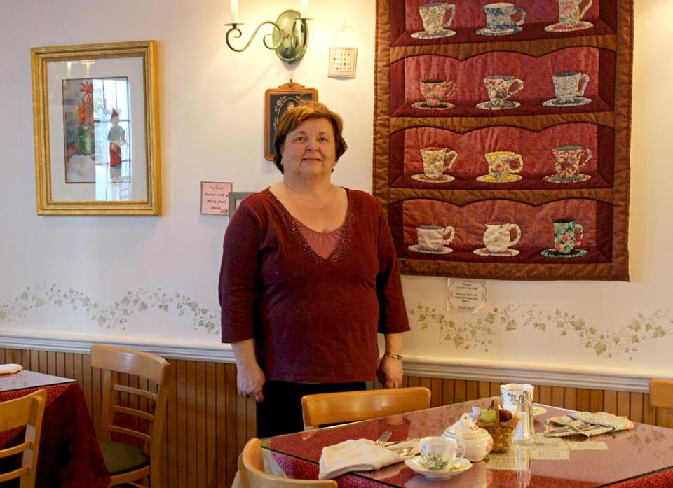 Judy McColgan, owner of Windsor Tea Shop & Tea Room in Cohasset. The quilt beside her is one made by her mother. Below, a tea plate of finger sandwiches, scones, and sweets.