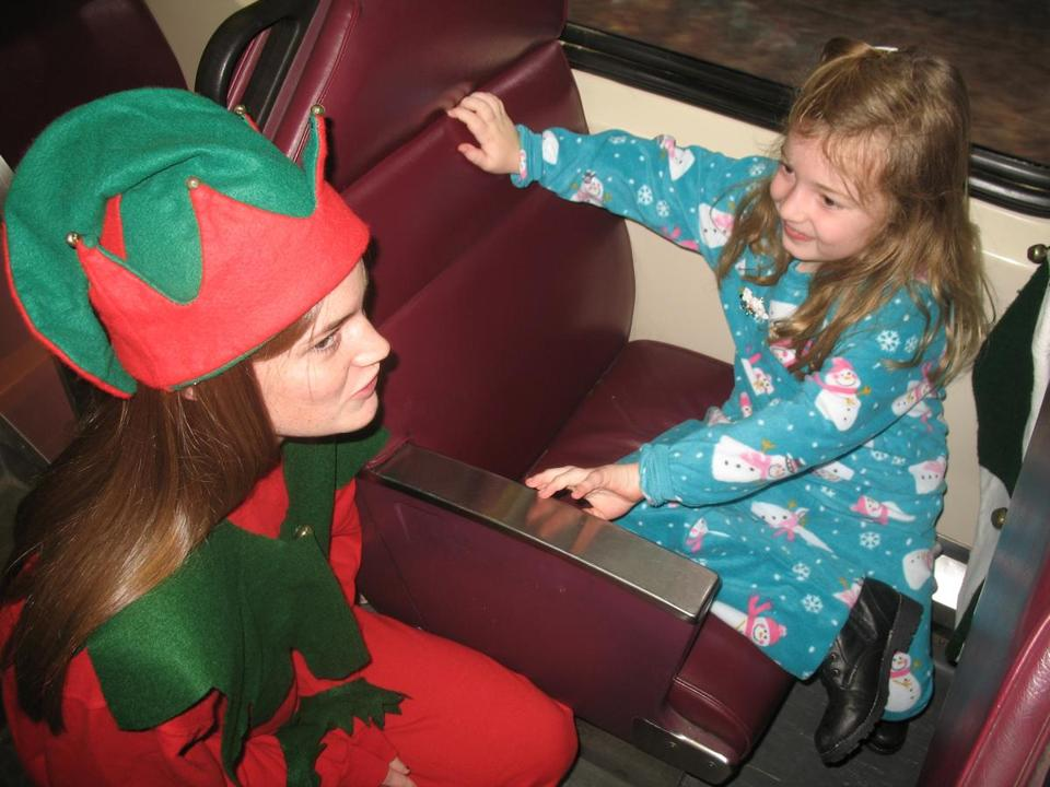 An elf talks to a young girl on the train during last year's South Shore Polar Express.