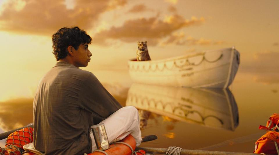 "Pi (Suraj Sharma) and a Bengal tiger known as Richard Parker in ""Life of Pi."""