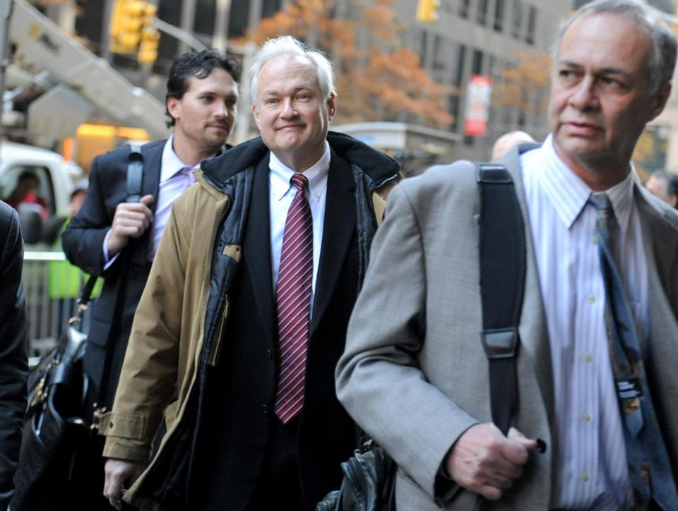 NHLPA executive director Donald Fehr (center) arrives for labor talks Wednesday.