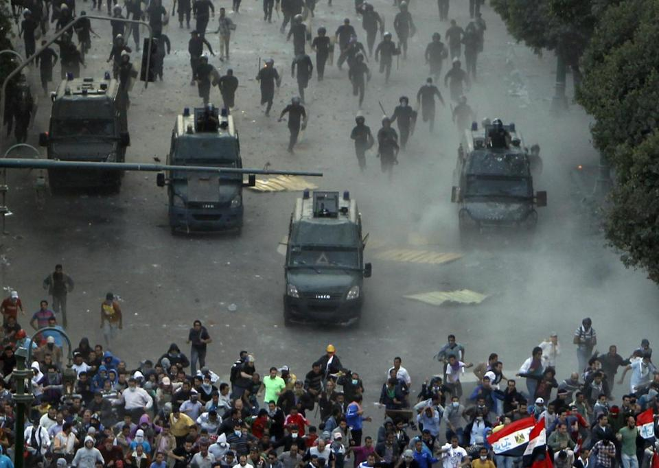 Riot police pushed backed protesters angry over decrees giving the president more power.