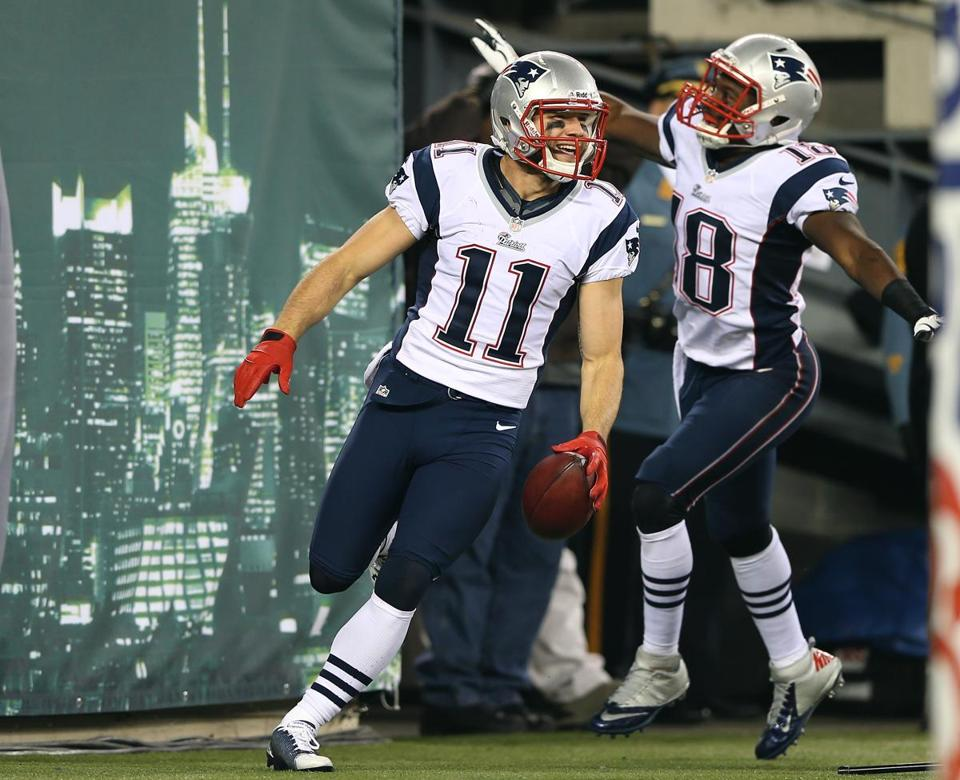 Patriots' Julian Edelman scored two touchdowns in the first half, but was taken out of the game with a head injury; his return was questionable.