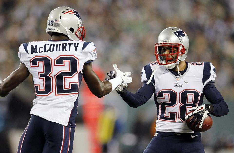 Safety Steve Gregory celebrates with teammate Devin McCourty following his interception against the Jets.