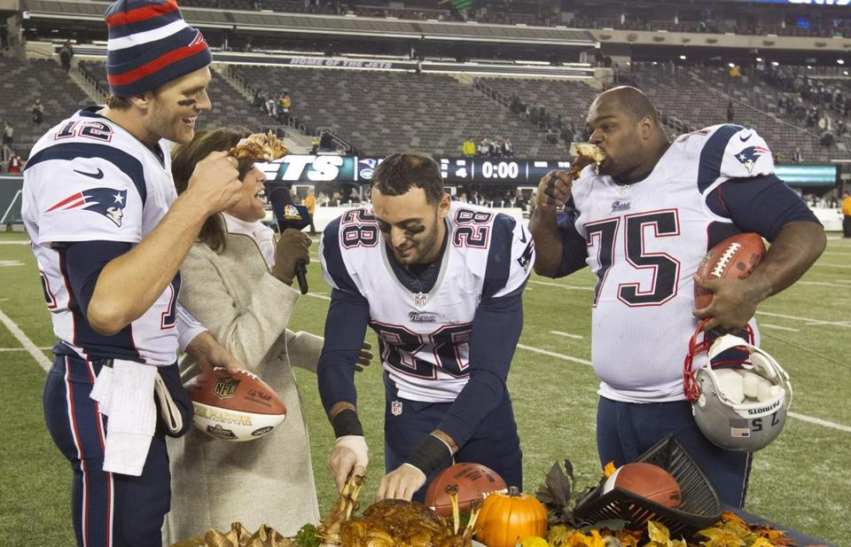 The Patriots were hungry for a win, and after they got it, Vince Wilfork (far left) was able to partake in a little snack.