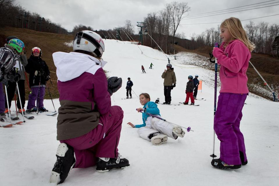 Lindsay Bogar (left), Rachel Shepard, and Lexi Swartz frolicked in the snow on Loon Mountain on Saturday in Lincoln, N.H.