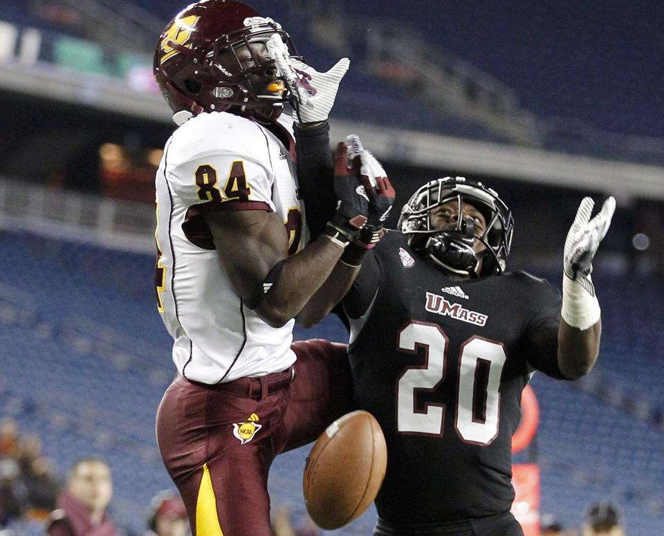 UMass defensive back Trey Dudley-Giles, right, broke up a pass intended for Central Michigan wide receiver Titus Davis in the third quarter.