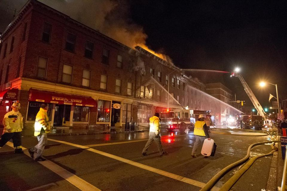 Firefighters in Leominster worked much of the night Saturday battling a fire at 65 Main St., which was once a hotel.