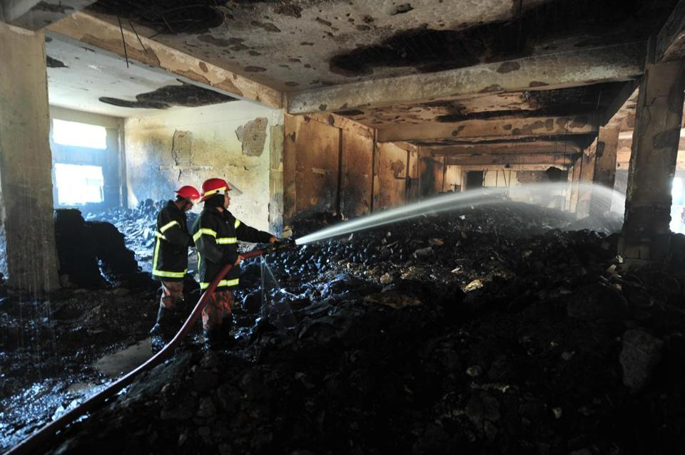 Firefighters extinguished a fire Sunday in the Tazreen Fashions plant in Savar, outside Dhaka, Bangladesh's capital.