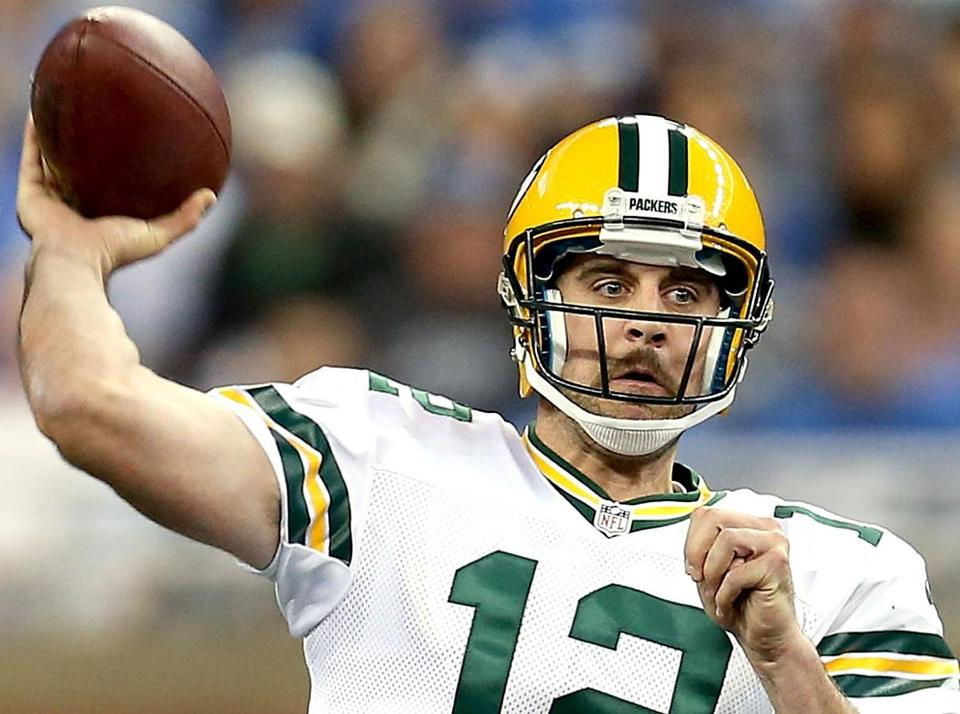 Quarterback Aaron Rodgers and Green Bay will play the Giants in a battle of the last two Super Bowl champions.