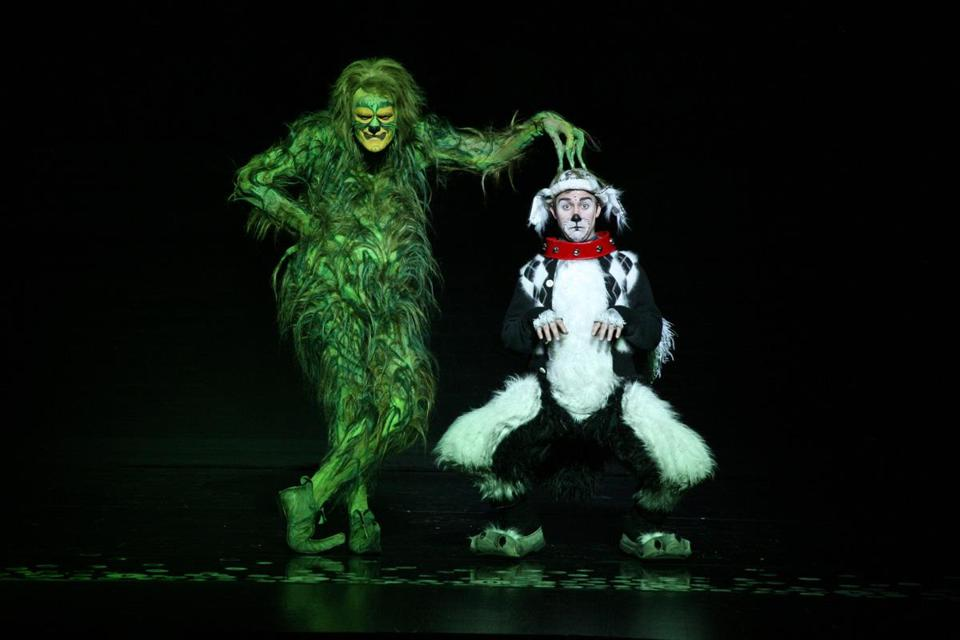 "The Grinch and Young Max the dog in the touring show of ""Dr. Seuss' How the Grinch Stole Christmas! The Musical,"" at the Citi Wang Theatre."