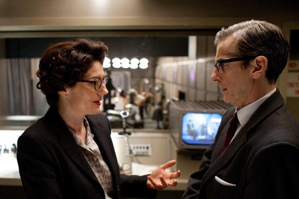 Lix (Anna Chancellor) and Randall (Peter Capaldi) are among the characters in the drama about a 1950s BBC newsmagazine.