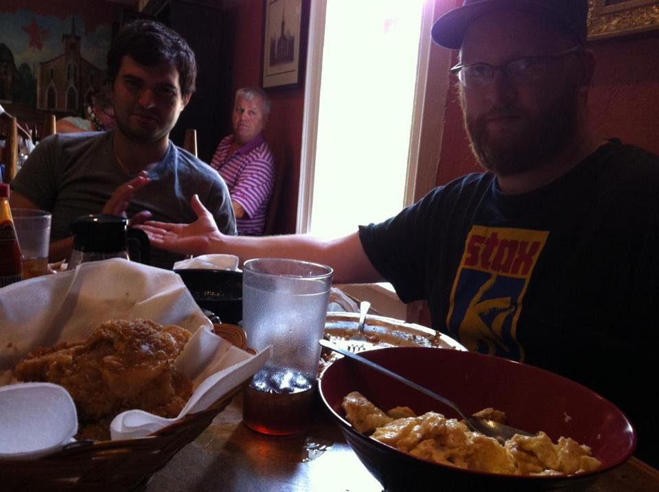 At Monell's in Nashville, Alex Carter (left) and Matt Snow at a communal table.