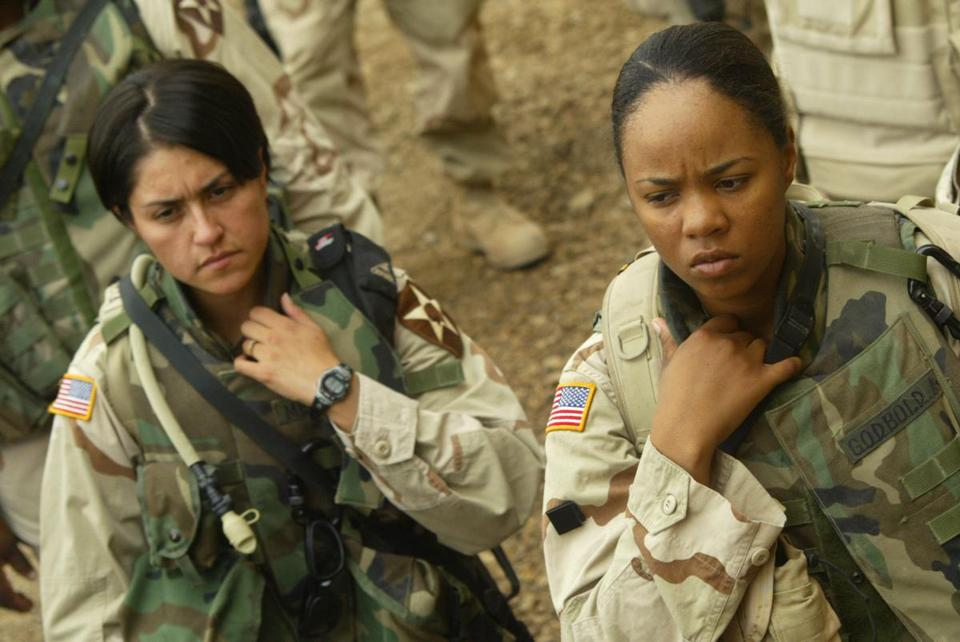 US Army female soldiers with the 2-17 Field Artillery Regiment listened to a briefing as they prepared to leave on a mission in Ramadi, Iraq, in 2004.