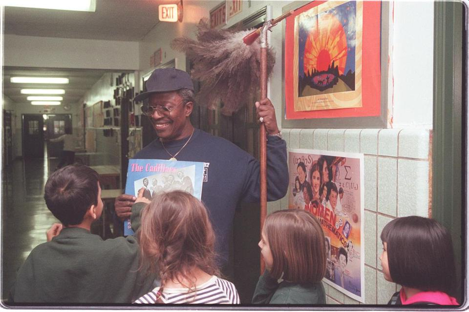 Mr. Carroll was asked by students to identify himself in a photo of the Cadillacs found in a book in 1998.