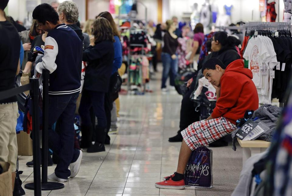 A boy waits for his family at a J.C. Penney store in Las Vegas on Black Friday. Major retailers reported weak November sales, which were linked to Superstorm Sandy.