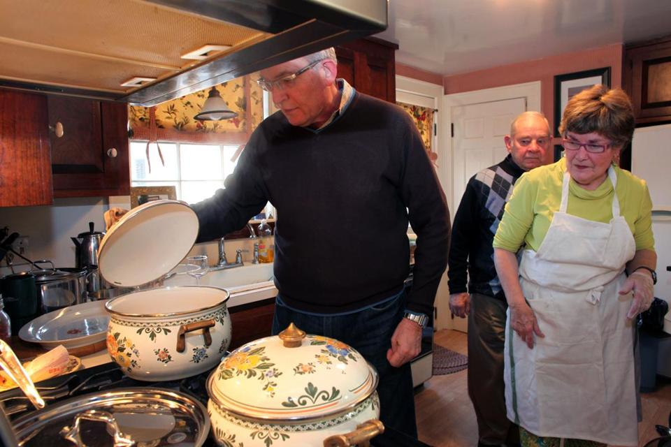 "Louis Risoli (left), maitre d' and fromager at L'Espalier, checked the anolini cooking on the stove, while Dorina O'Connell and her uncle Al Botti looked on. ""If you don't have good broth, you won't have good anolini,"" says Risoli."