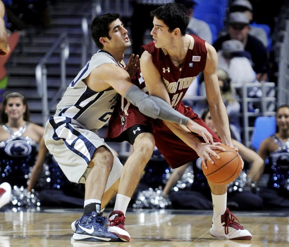 Boston College's Danny Rubin, right, looks to pass as Penn State's Nick Colella defends.