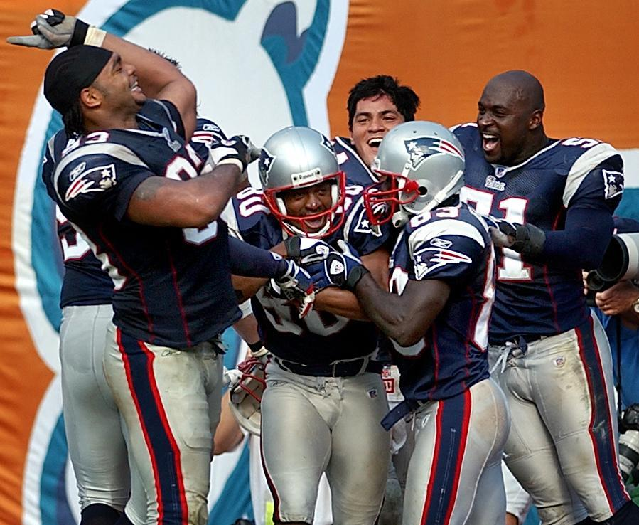 Patriots players celebrated with Troy Brown after his game-ending touchdown.