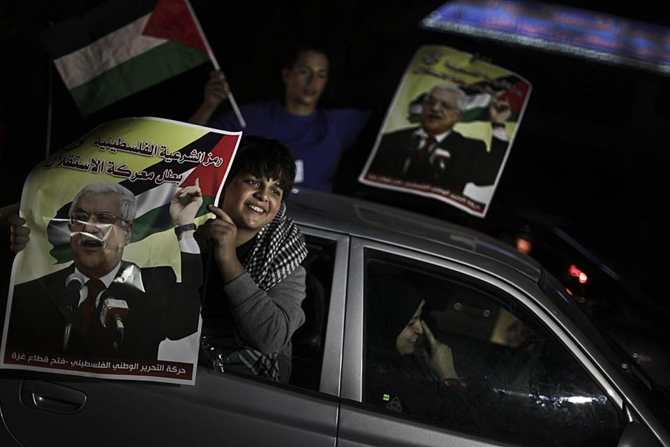 Palestinians celebrated in the streets of Gaza City after the UN General Assembly voted 138-9 with 41 countries abstaining to upgrade the Palestinian status to a nonmember state, tacitly acknowledging Palestine as a state.
