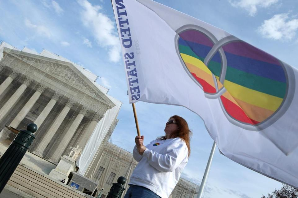 Kat McGuckin of Oaklyn, N.J., held a gay marriage pride flag in front of the Supreme Court on Friday.