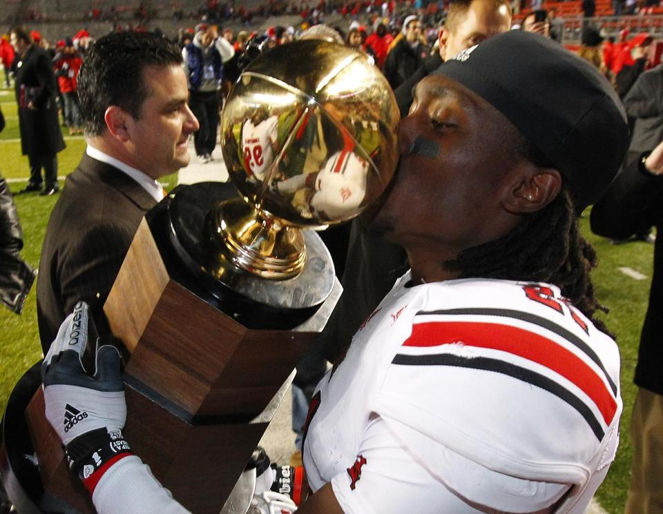 Louisville's Adrian Bushell embraced the Big East Championship trophy. The Cardinals will be going to the BCS for the second time, their first since 2006.