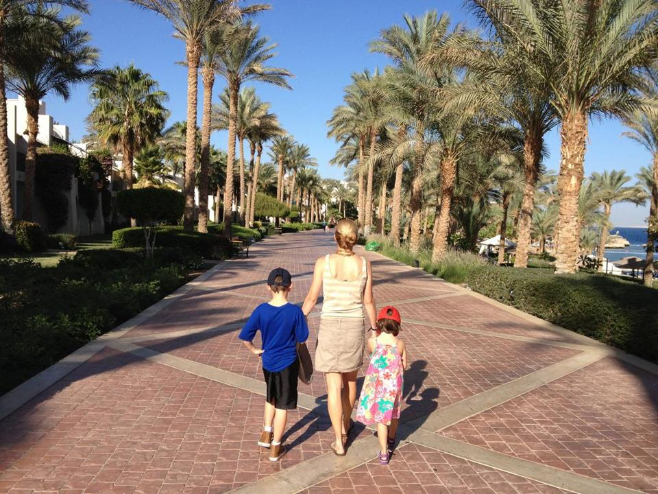The author with her children on the grounds of the Grand Rotana Resort and Spa at Sharm el Sheikh, in South Sinai, and, below, with her family at the Pyramids of Giza.