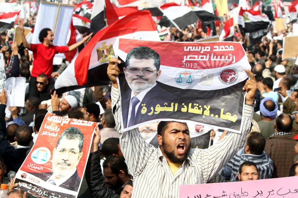 Supporters of the Muslim Brotherhood held flags at a demonstration for President Mohammed Morsi in Cairo.