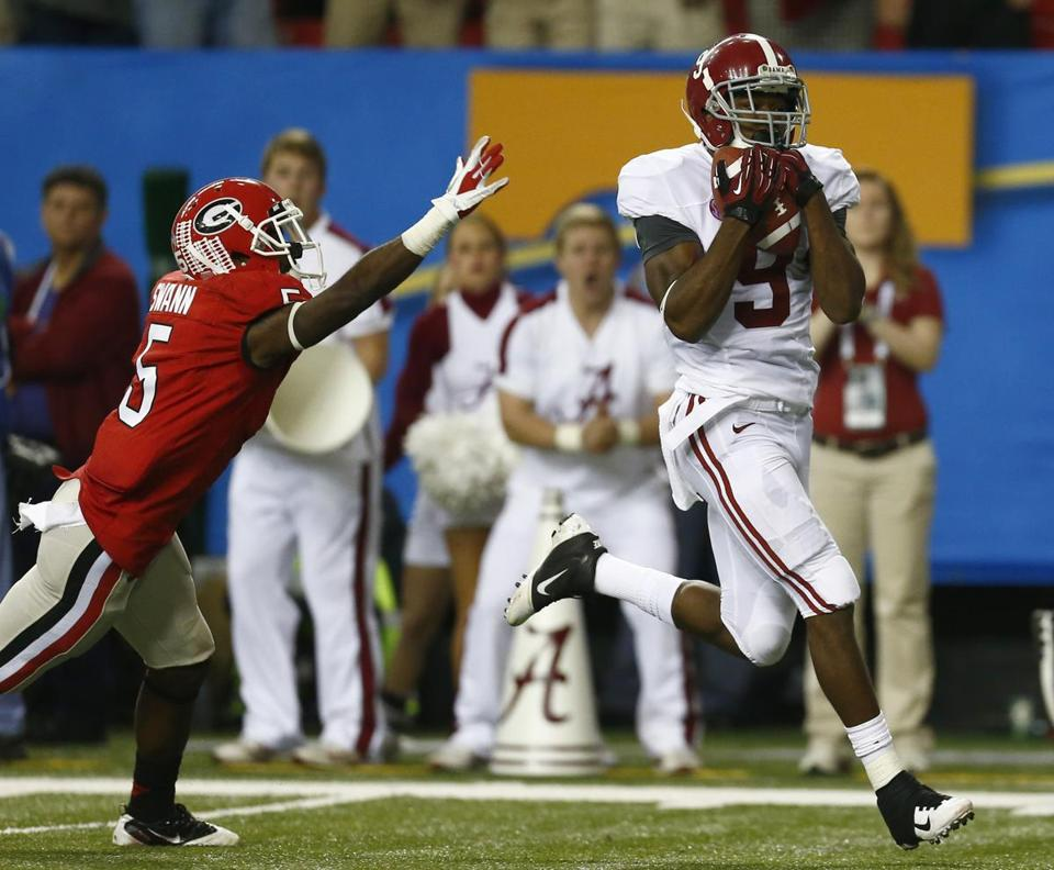 Alabama wide receiver Amari Cooper pulled in a pass ahead of Georgia cornerback Damian Swann for a fourth-quarter touchdown.