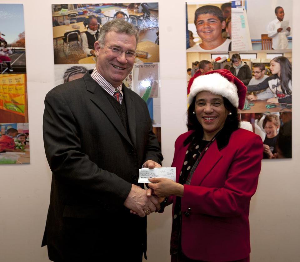 Globe publisher Chris Mayer accepted $250 for Globe Santa from Carol Johnson, Boston school superintendent.