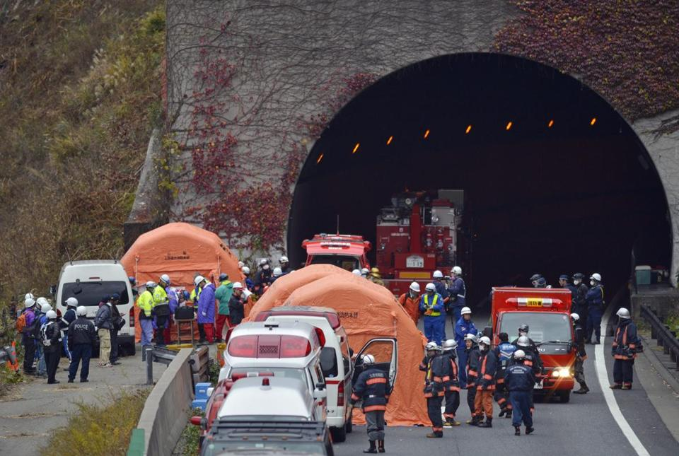 Firefighters and other rescue personnel worked on Sunday at the Sasago Tunnel near the city of Otsuki, west of Tokyo.
