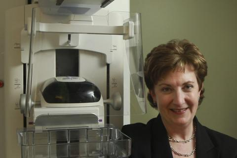Dr. Elizabeth Rafferty, director of breast imaging at Massachusetts General Hospital, with a tomosynthesis device, which is used to help generate digital 3-D mammograms.