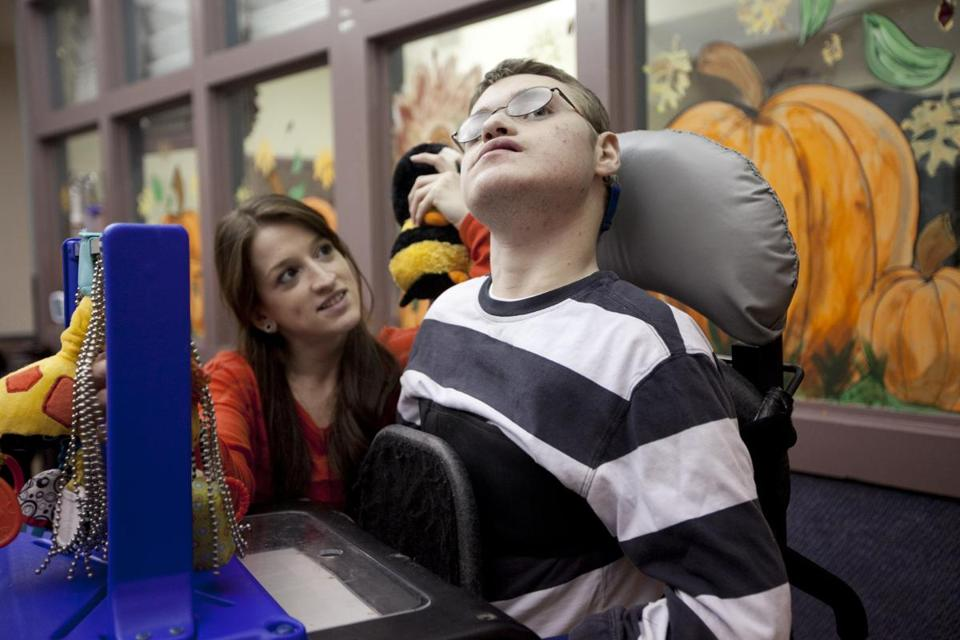 Brett, 19, interacts with residential counselor Nicole Pacheco at Aspen House, a children's residence.