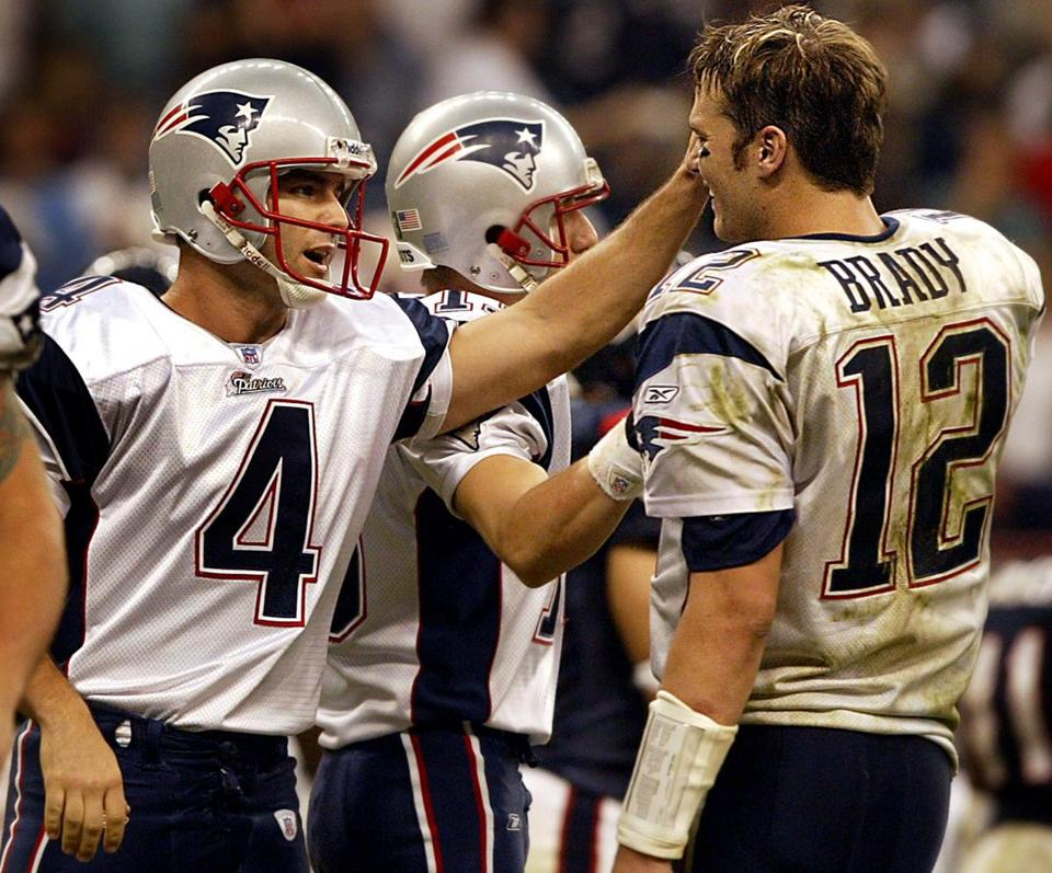 Adam Vinatieri  and Tom Brady celebrated after New England closed out the victory.