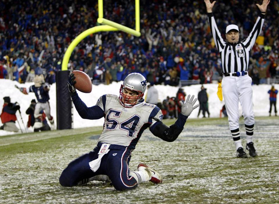 Tedy Bruschi's touchdown after intercepting a Jay Fiedler pass in the fourth quarter helped seal the win for the Patriots.