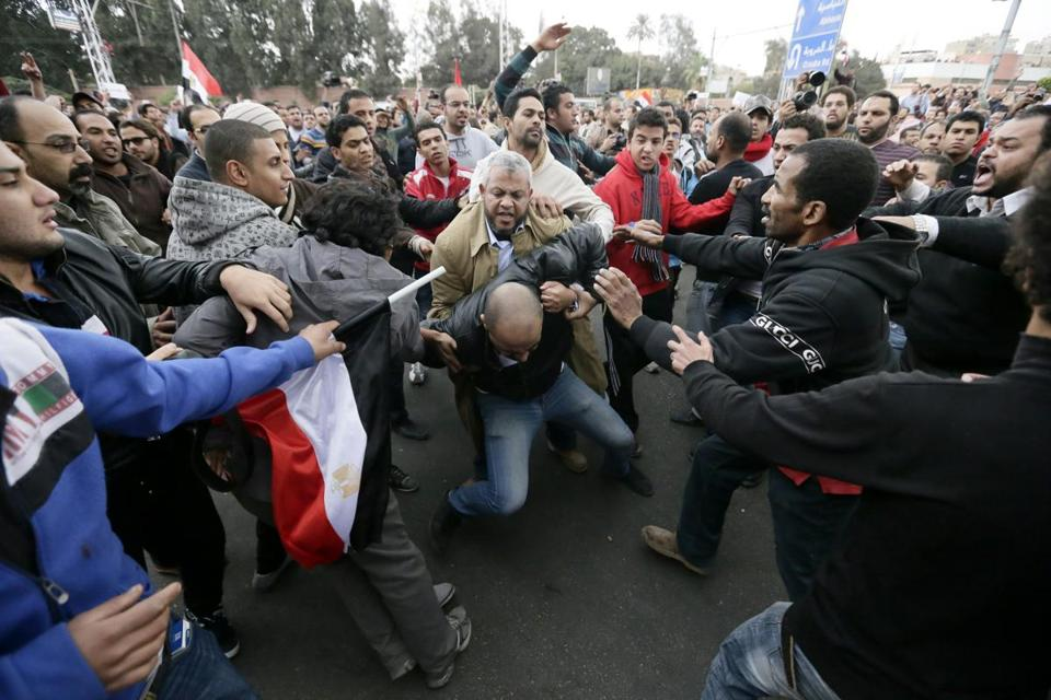 At least 211 people were wounded in violence outside the presidential palace Wednesday.