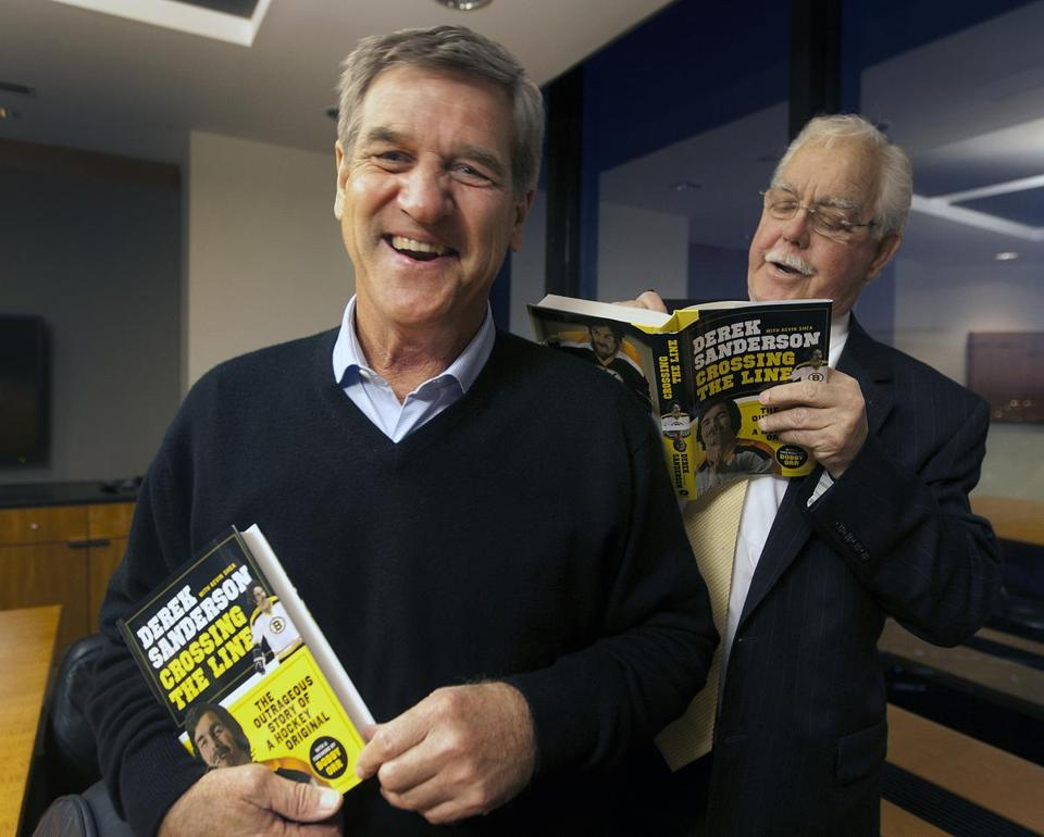 Bobby Orr (left) and Derek Sanderson at a recent investment service event.