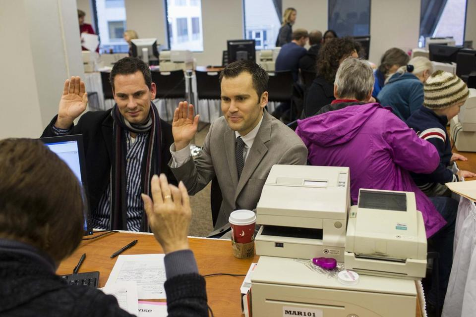 David Mifflin and Matt Beebe took an oath for a marriage license in Seattle. Voters backed gay marriage last month.