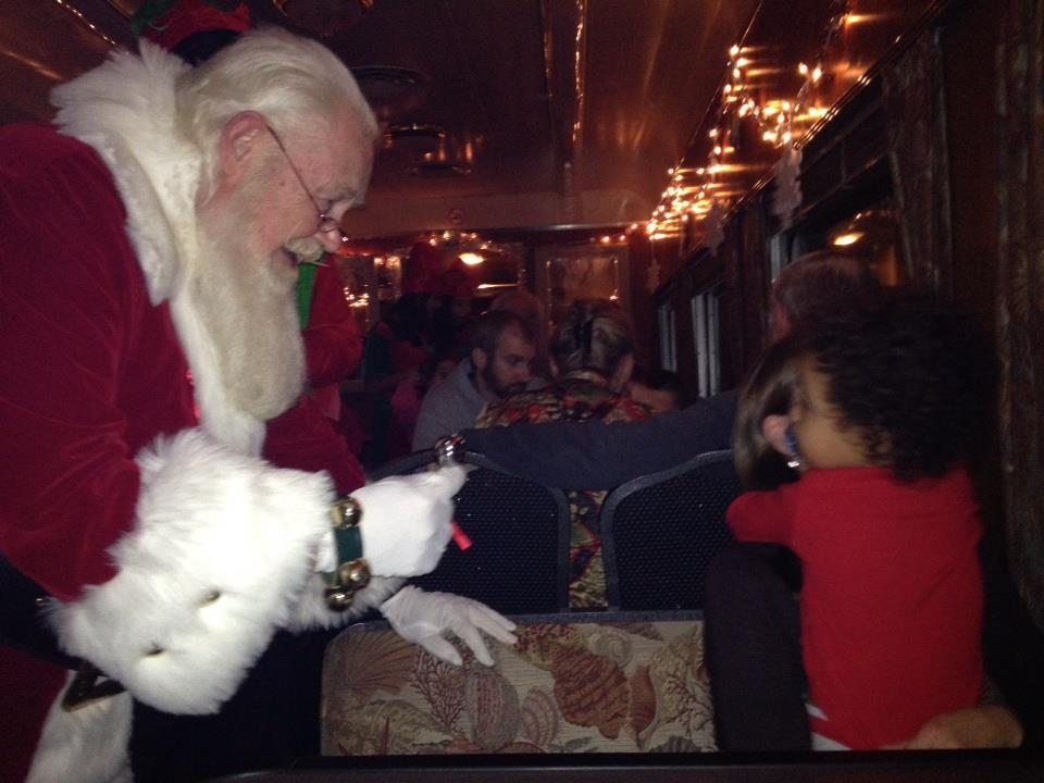 Santa Claus interacted with Max on the Polar Express Train Ride in Buzzards Bay.