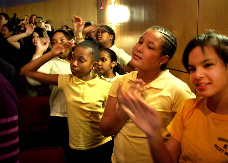 Students at the Orchard Gardens School in Roxbury mimicked ballet moves Thursday as they watched a performance.