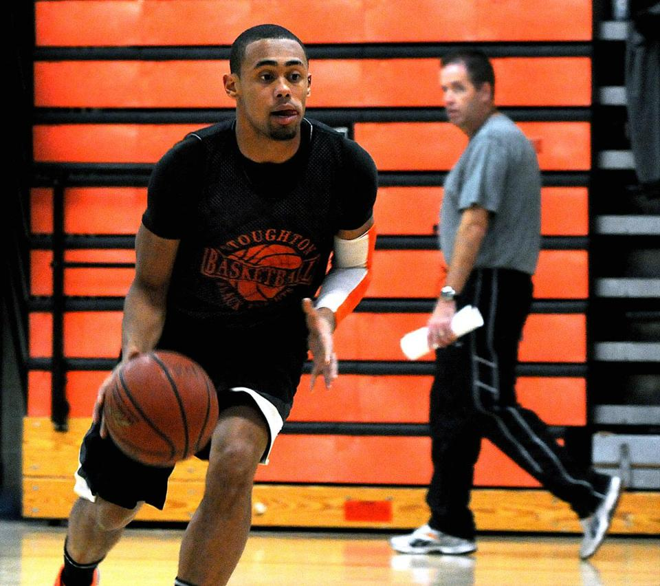 Stoughton High senior guard Marcus Middleton runs a drill as head coach John Gallivan keeps a close watch at practice. With its star gone, the team will rely on experienced players including (below, from left) Middleton, Mauro Oliveira, and Joe Bunce-Grenon.