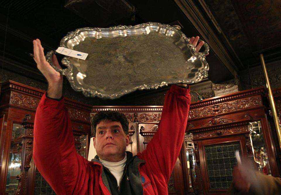 Ralph Stewart held a vintage silver platter from restaurant Locke-Ober at an auction on Friday.
