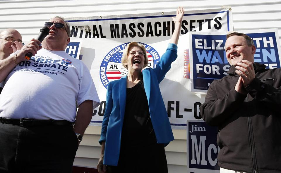 Elizabeth Warren waves during a campaign rally with union workers in Auburn on Nov. 3.
