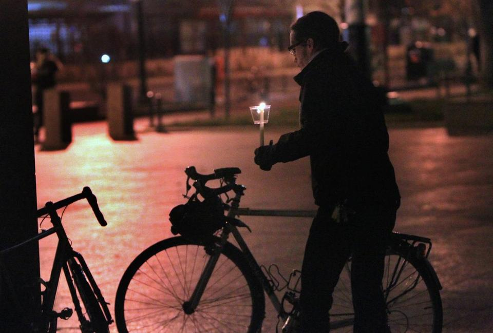 A bicyclist parked his bike Dec. 6 while joining a gathering of Boston University students, passersby, and others in front of Marsh Chapel for a candlelight vigil for BU graduate student Christopher Weigl, who was killed on his bike in a collision with a tractor-trailer.