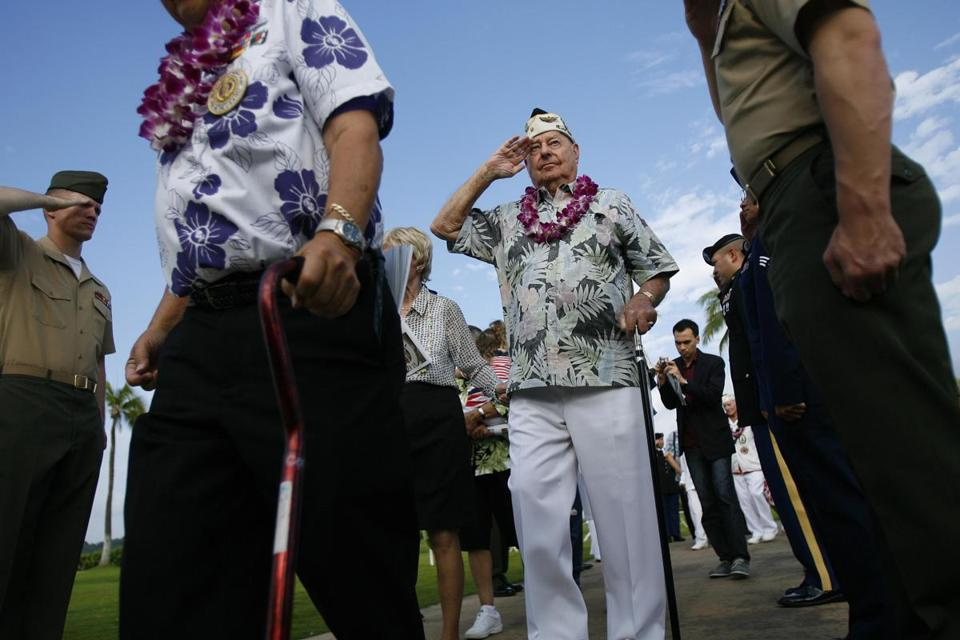 "USS Arizona survivor Lou Conter saluted during the ""Walk of Honor"" at the ceremony marking the Pearl Harbor attack."